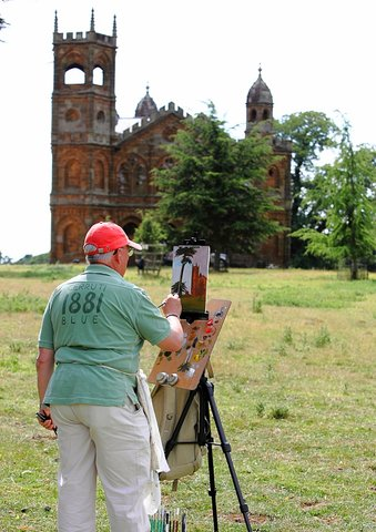 Peter Baker painting on location near the Gothic Temple in the Stowe National Trust Landscape Gardens